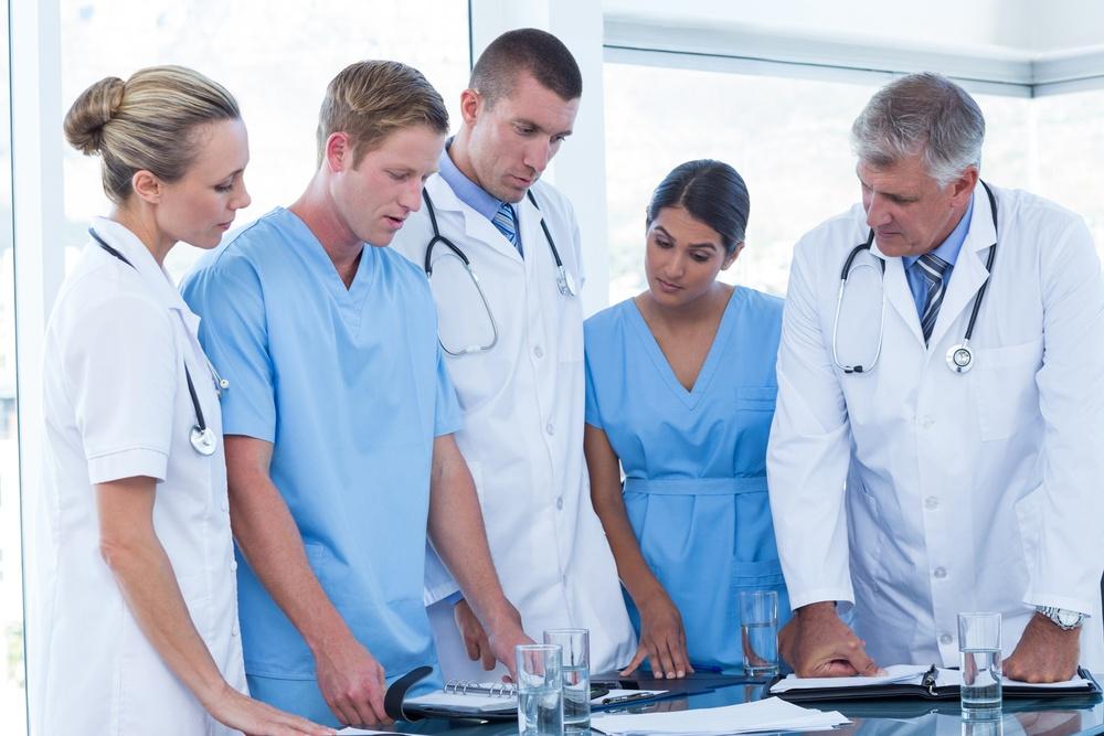 Team of doctors looking at their diaries in the meeting room.jpeg