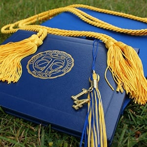 Earning a Bachelor of Science in Nursing (BSN) degree from an accredited college or university